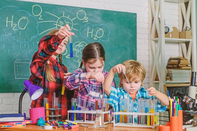Pupils in the chemistry class. back to school. Educational concept. happy children. children scientists making stock photography