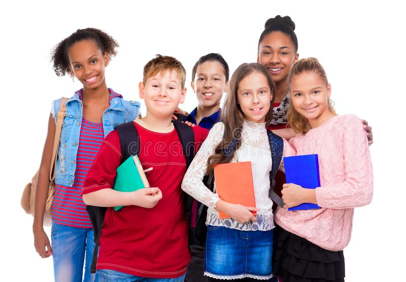 Pupils with different complexion and clothes royalty free stock images