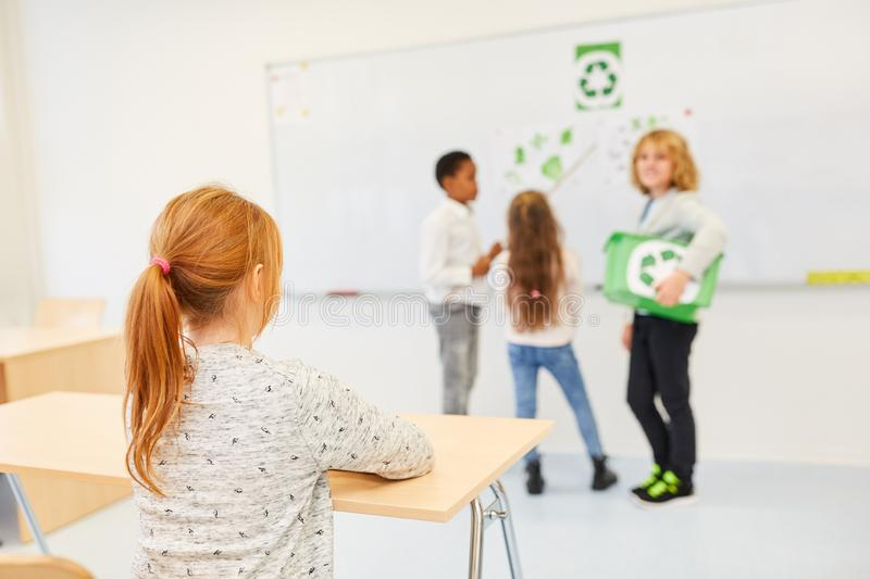 Paper on recycling and environmental protection. Pupils in elementary school give a paper on recycling and environmental protection royalty free stock images