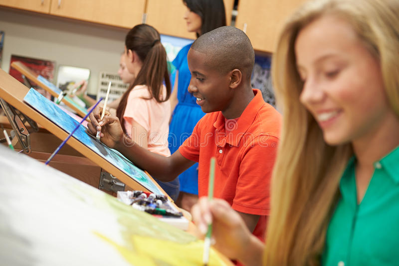 Pupils In High School Art Class. With Teach In Background royalty free stock images