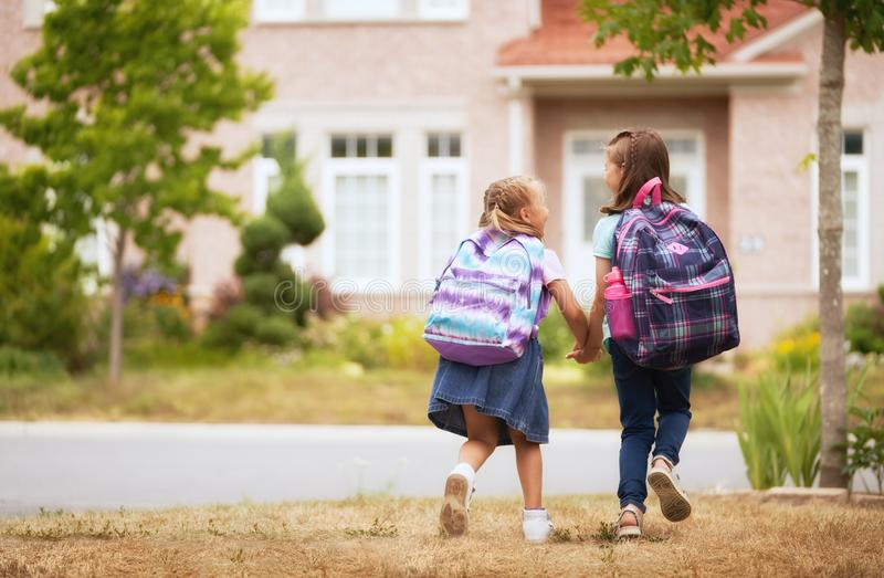 Girls with backpack is going to school royalty free stock photos
