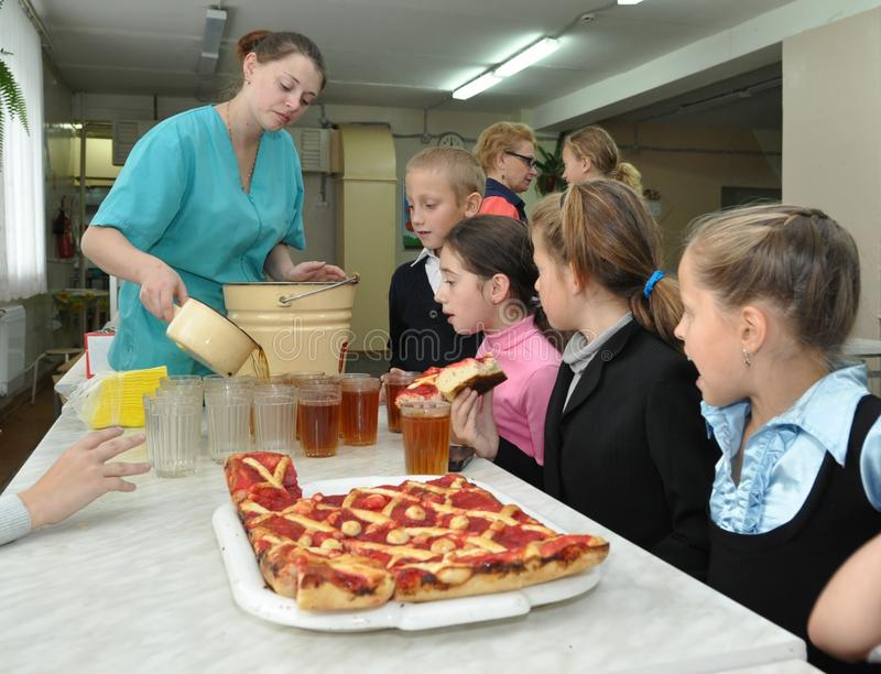 Pupils in the school cafeteria royalty free stock photography