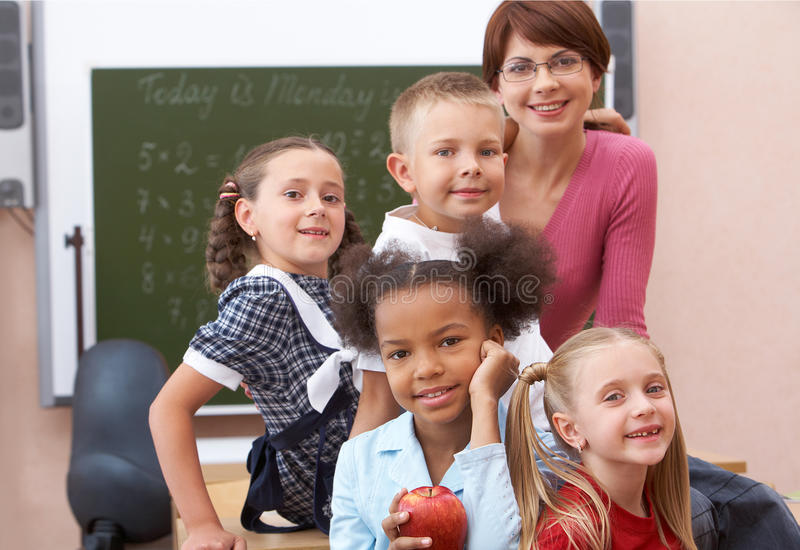 Download Pupils and teacher stock photo. Image of background, looking - 15104624