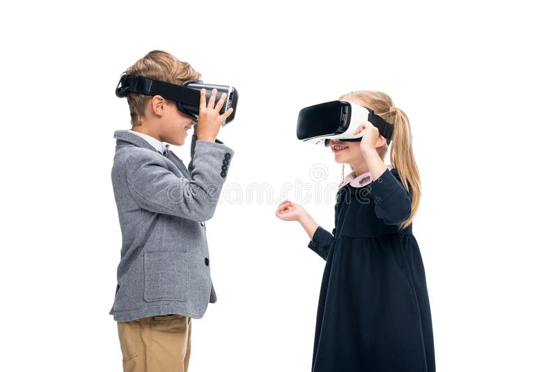 Pupils in VR headsets. Adorable pupils in VR headsets isolated on white royalty free stock photography