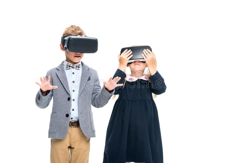 Pupils in VR headsets. Adorable pupils in VR headsets isolated on white stock image
