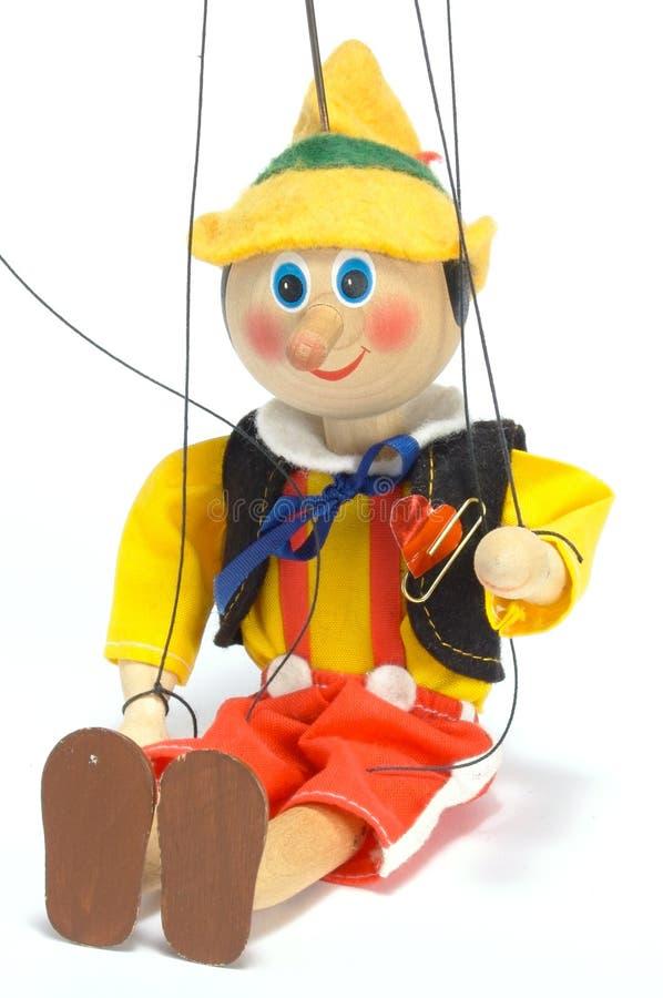 Puppe sitzt stockbilder