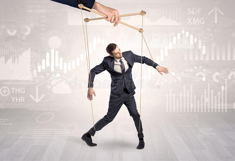 Puppet businessman with financial concept royalty free stock image