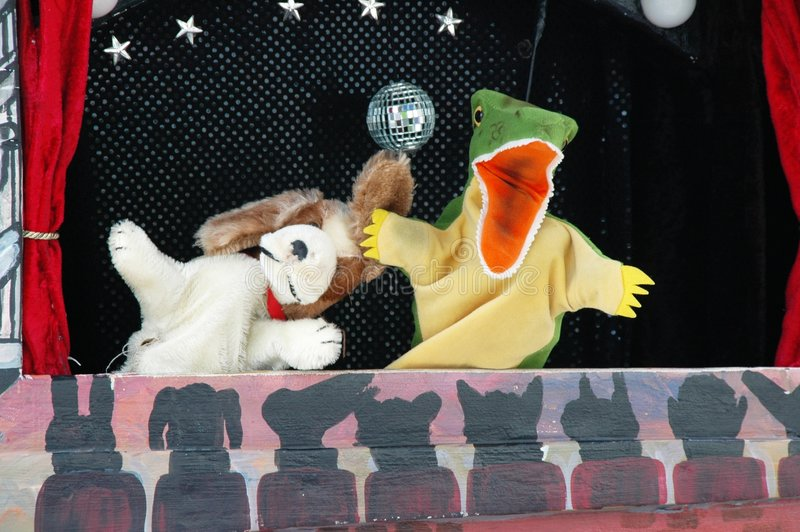 Puppet Show. A dog and crocodile puppet show royalty free stock photos