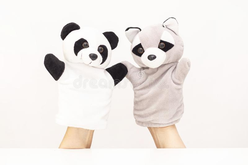 puppet theater on a white background. friendly animals hold hands. The concept of playing with children, friendship, royalty free stock photos