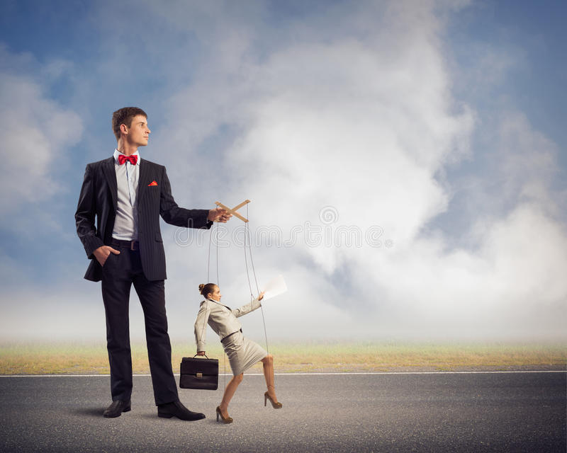 Puppeteer and business woman royalty free stock photo