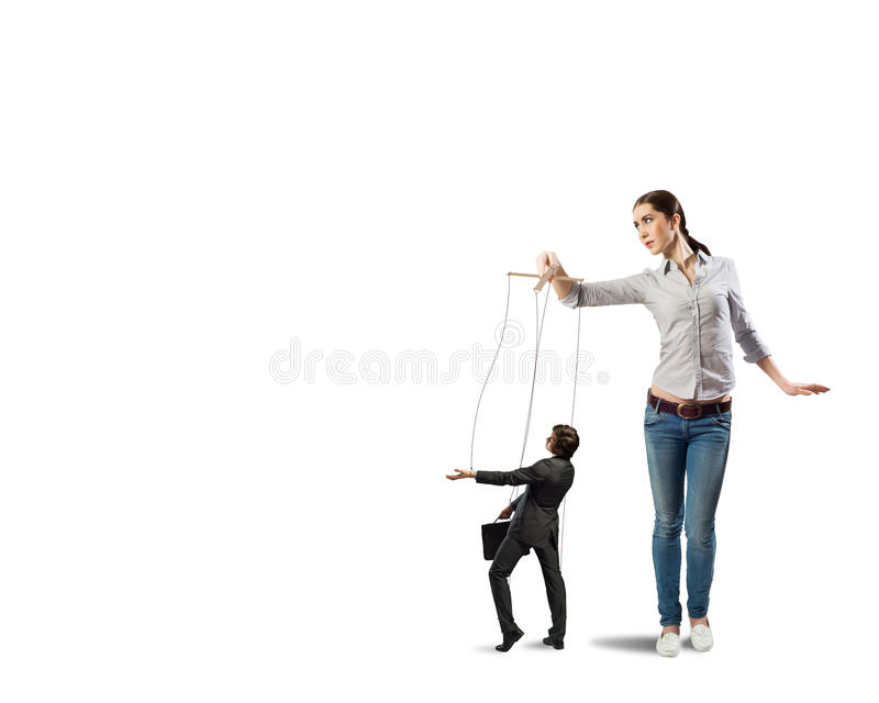 Puppeteer controls a businessman royalty free stock photo
