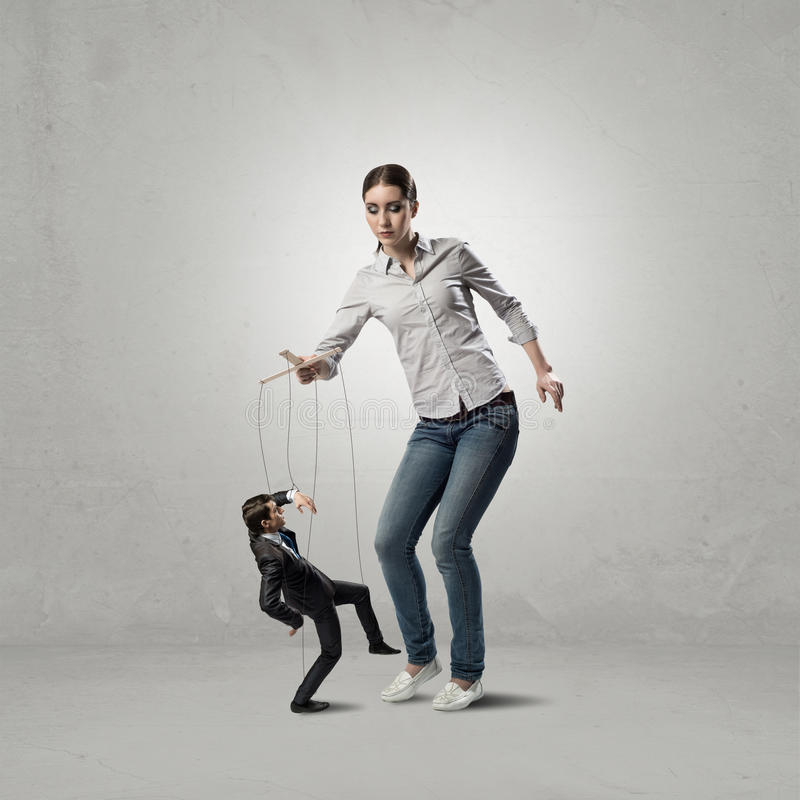 Puppeteer controls a businessman stock photo