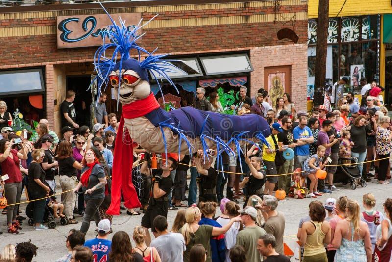 Puppeteers Carry Giant Caterpillar Puppet In Atlanta Halloween Parade stock photos