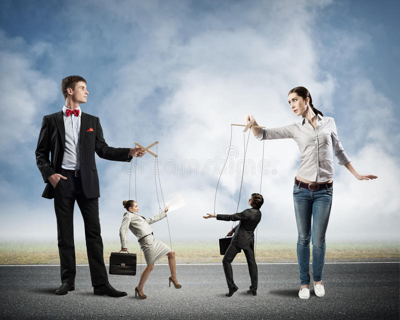 Puppets and puppeteers business stock photo