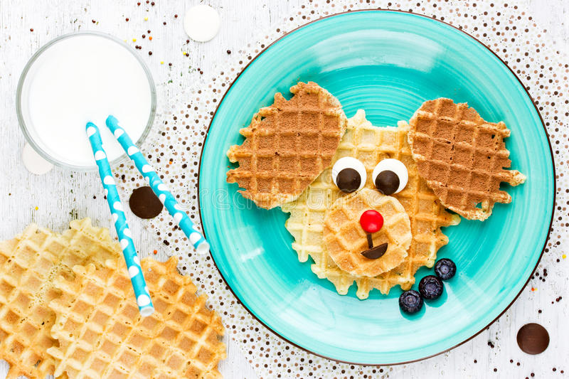 Puppy dog waffles for baby breakfast. Animal-shaped adorable art royalty free stock images