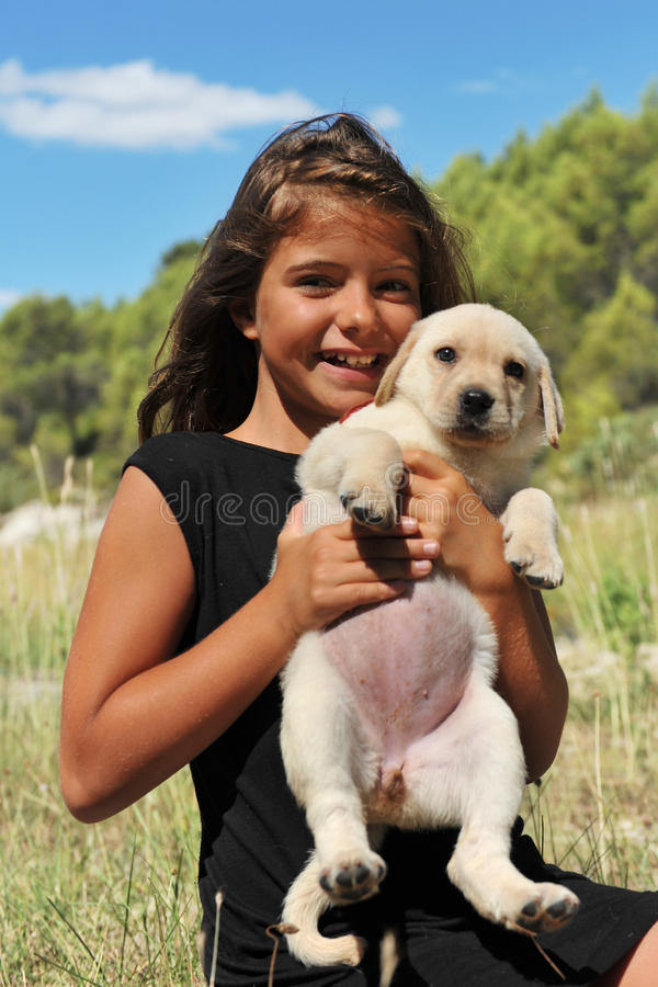 Download Puppy Labrador And Smiling Girl Stock Photo - Image of stroking, purebred: 23007256