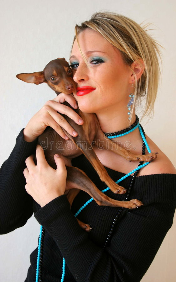 Puppy love. A woman and her pet dog royalty free stock photography