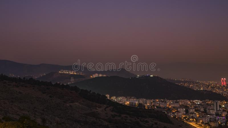 Puprle Sky in Izmir. View of purple sky just before the full moon rises in Izmir, Turkey royalty free stock photo