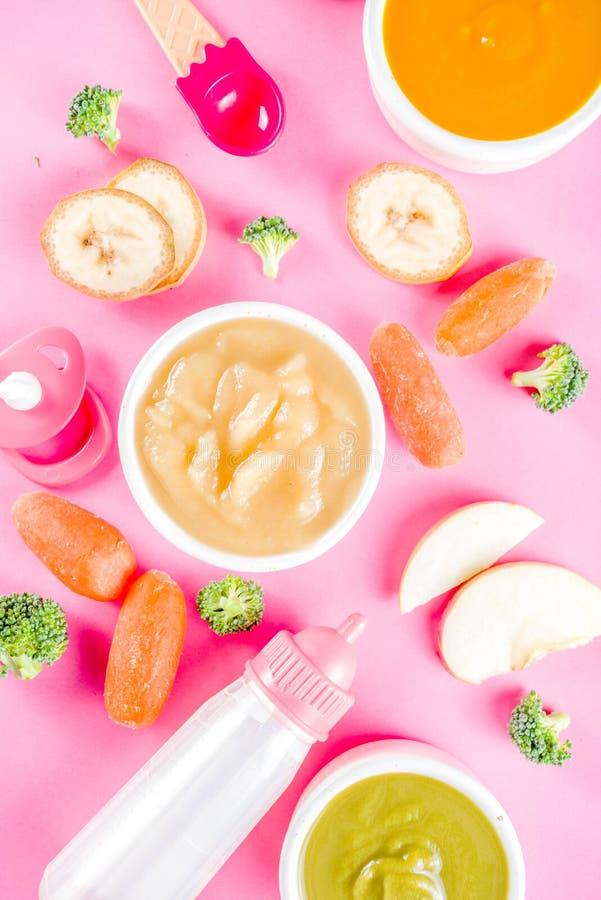 Puré colorido do comida para bebê fotografia de stock