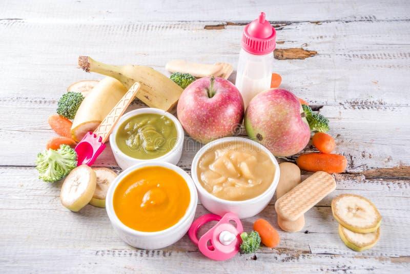 Puré colorido do comida para bebê imagem de stock royalty free