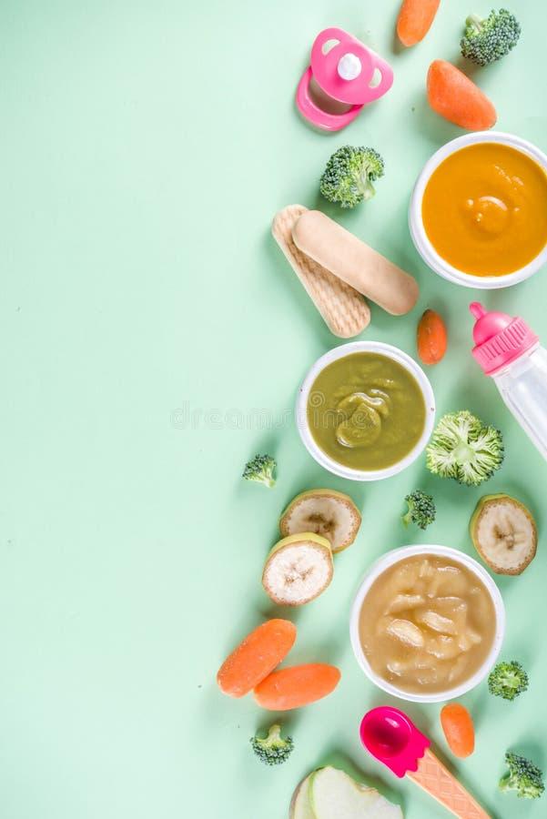 Puré colorido do comida para bebê foto de stock