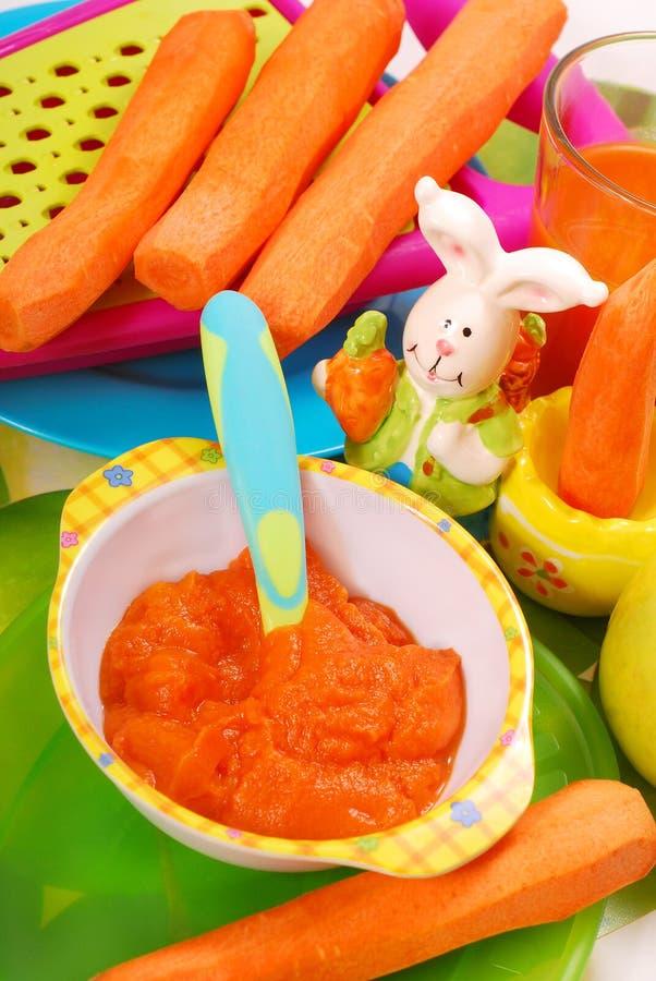 Puré da cenoura para o bebê imagem de stock royalty free
