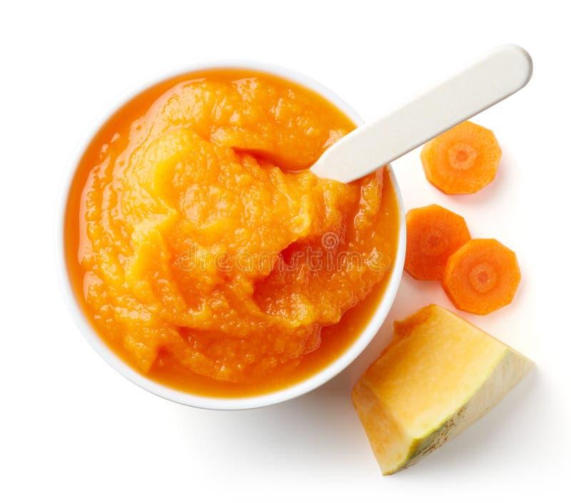 Puré del bebé de la calabaza y de la zanahoria en blanco imagen de archivo libre de regalías
