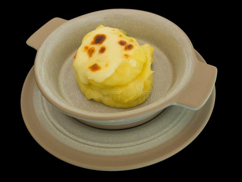Purés de patata con el queso aislado en el ingenio negro del fondo fotos de archivo libres de regalías