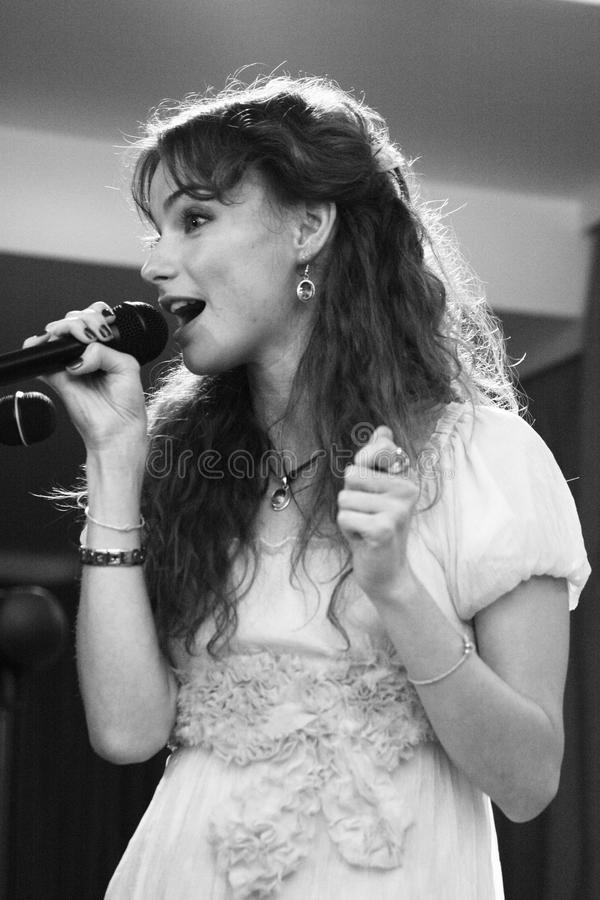 Pur:pur band performance. KHARKIV - OCTOBER 2: Nata Smirina, Pur:Pur band vocalist performs on stage at Jazzter club on October 2, 2009 in Kharkiv, Ukraine royalty free stock photo