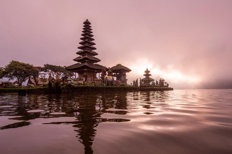 Pura Ulun Danu Beratan, or Pura Bratan, is a major Shaivite water temple on Bali, Indonesia. The temple complex is located on the. Shores of Lake Bratan in the stock image