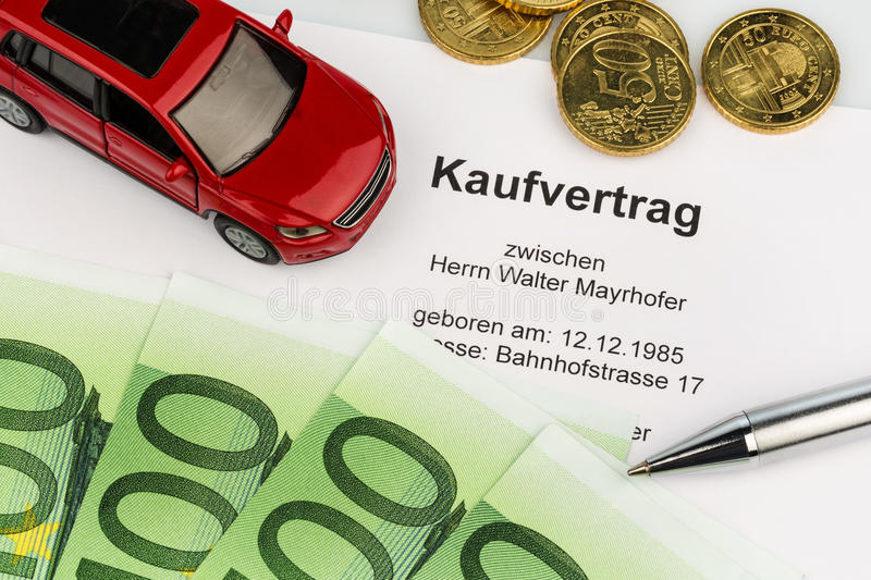 Purchase agreement for car. A contract of sale for buying a car at the car dealer. cars stock images