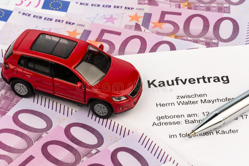 Purchase agreement for car. A contract of sale for buying a car at the car dealer. cars for sale stock photo