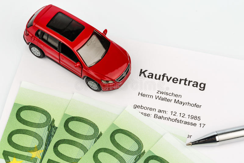 Purchase agreement for car. A purchase contract to buy a car at the car dealer. new and used cars royalty free stock photo