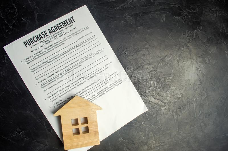 Purchase agreement. The concept of buying a home, real estate, apartment. Services realtor and real estate agent. Sale / sold hous. E. selective focus stock images