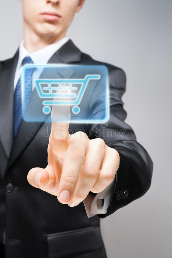 Purchase. Businessman performing online purchase, pushing virtual shopping cart button stock image