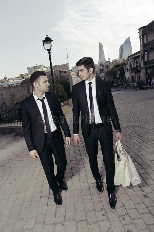 Purchase of businessmen,shopping guys stock photography