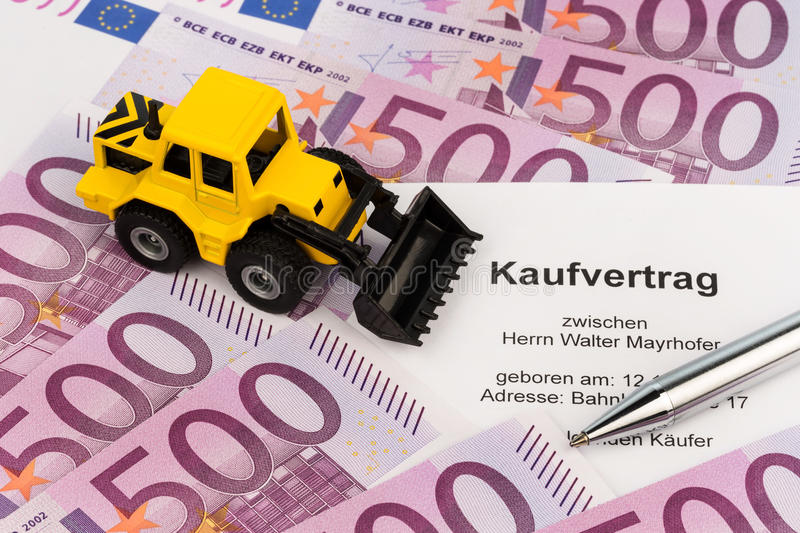 Purchase contract for new excavator. The purchase contract for a new excavator. with euro money and pen royalty free stock photos