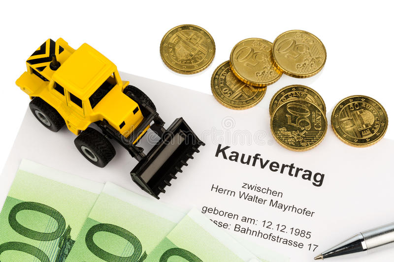 Purchase contract for new excavator. A purchase contract for new excavator. investing in new vehicles brings cost advantages royalty free stock photo