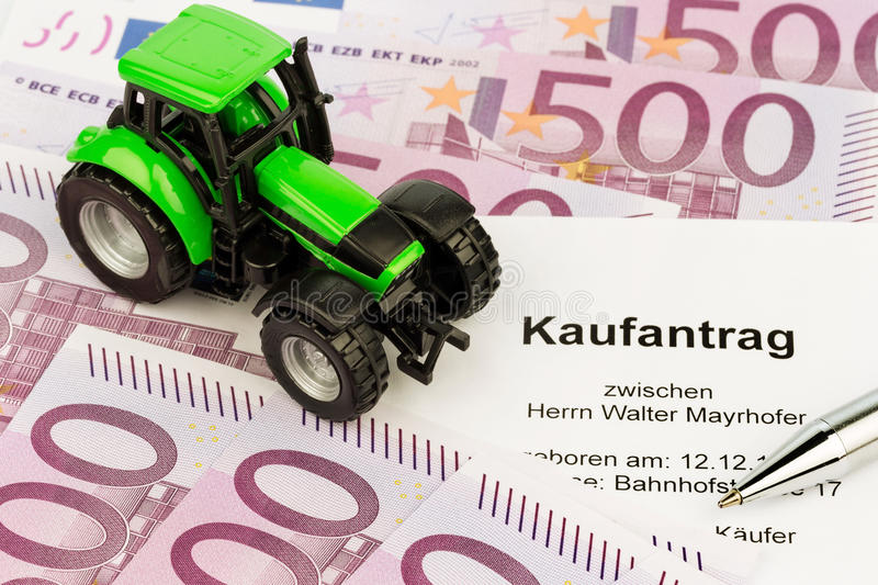 Purchase contract for the new tractor stock photography