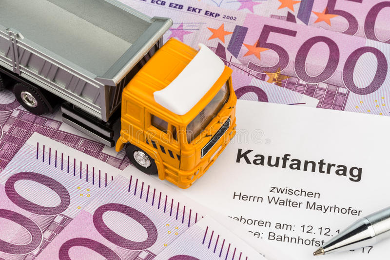 Purchase contract for new truck. A contract to purchase a new truck. invest in new vehicles has cost advantages stock photo