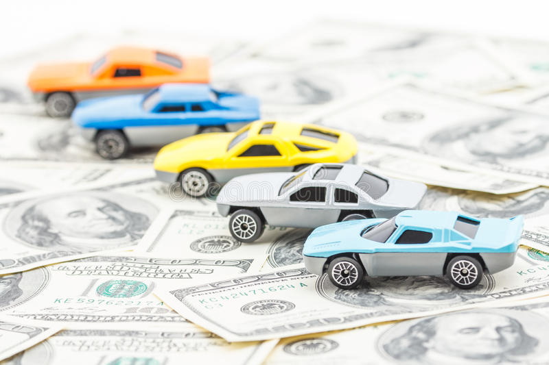 Purchase and sale of cars by money. Concept of purchase and sale of cars royalty free stock photography