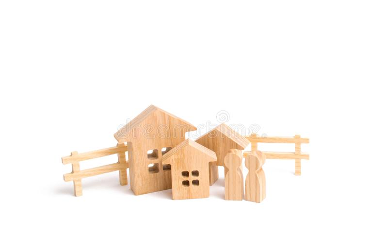 Purchase and sale of real estate, investment. Construction of farms of industrial complexes. Wooden houses and people. On a white background. The concept of stock images