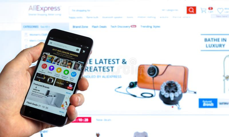 Purchase via mobile app on a Global marketplace with products from manufacturers from China Ali Express on the screen of smartphon stock images