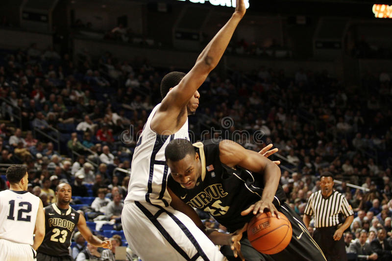 Purdue's #25 JuJuan Johnson is defended by Andrew Jones royalty free stock image