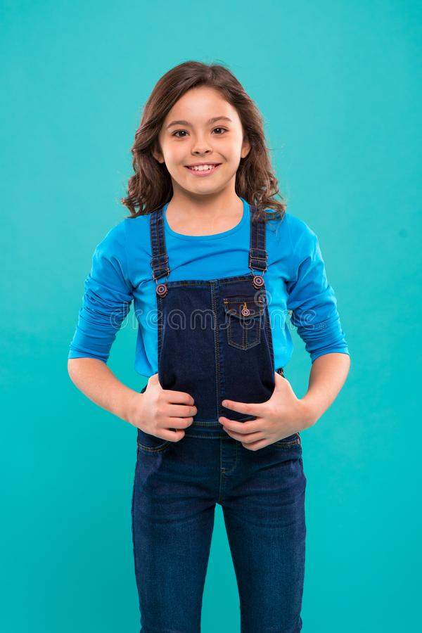 Pure beauty. Little girl with long hair. Kid happy cute face with adorable curly hair stand over blue background. Beauty. Tips for tidy hair. Kid girl long stock photos