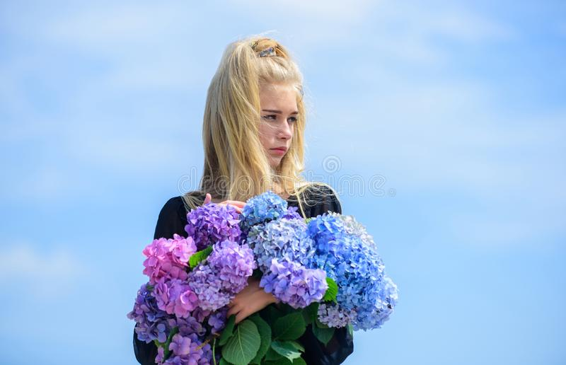 Pure beauty. Beauty of spring season. Girl tender blonde hold hydrangea bouquet. Skin care and beauty treatment. Springtime bloom. Gentle flowers for delicate stock photography