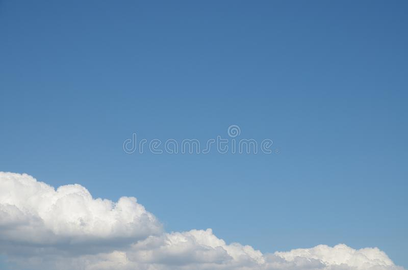 Pure blue sky over white clouds royalty free stock photography
