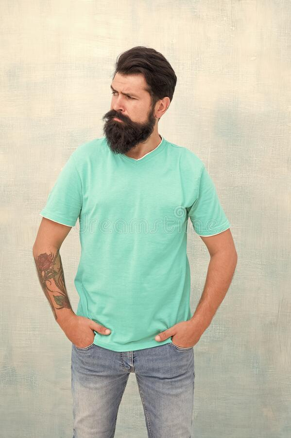Pure brutal. Hipster wear long beard and mustache in brutal style. Bearded man with brutal look. Brutal caucasian guy royalty free stock image
