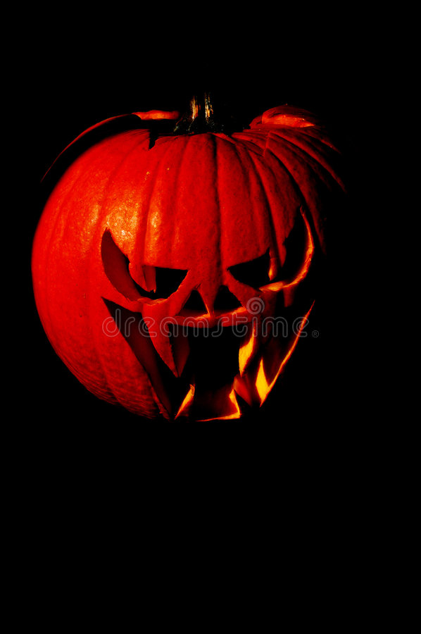 Pure Evil. Scary Jackolantern in dramatic lighting royalty free stock photo