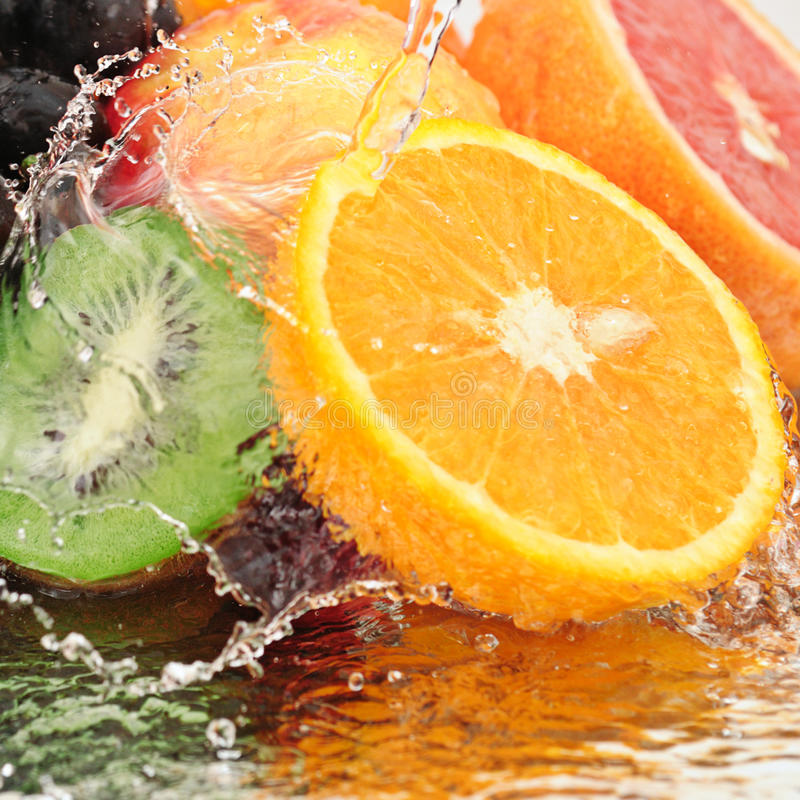 Pure fruit. In spray of water stock photos